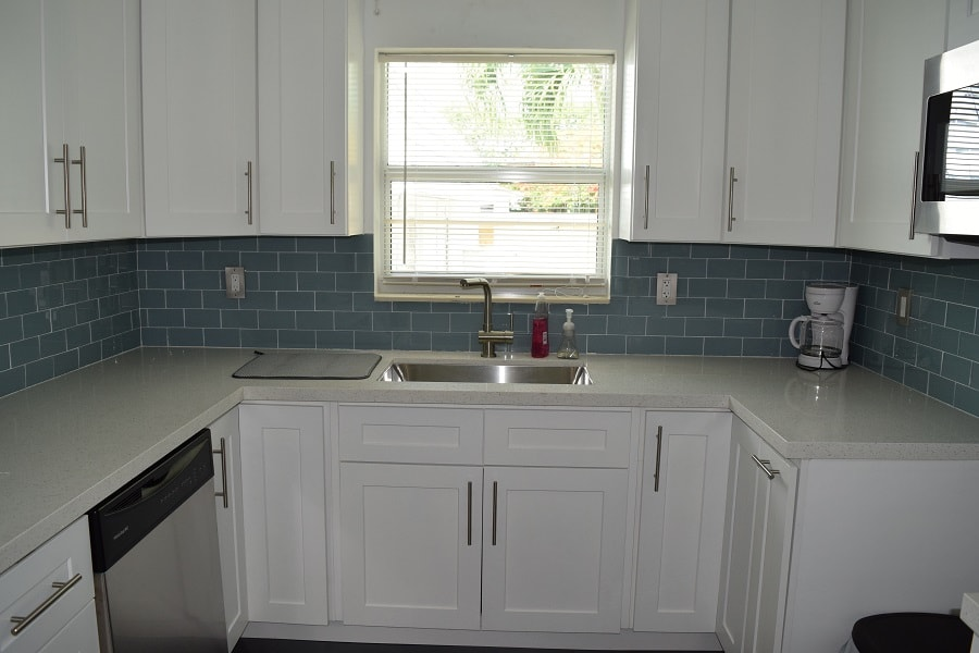baby blue tile backsplash with white cabinetry